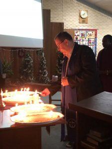 Presbytery Minister lighting a candle